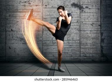 Athletic Woman kicks