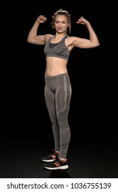 athletic woman shows her muscles, the whole figure