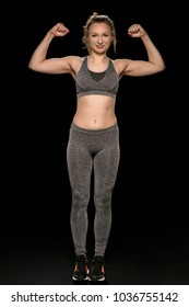 athletic woman shows her shapely body and muscles