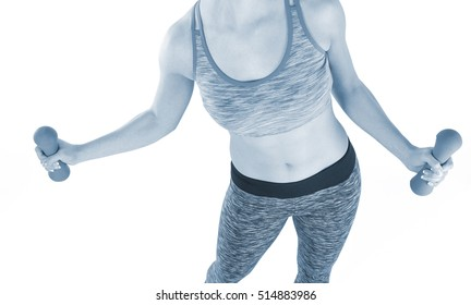 Athletic woman in sports wear lifting weights while doing aerobics.