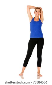 Athletic woman stretching - isolated over a white background