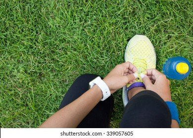 athletic woman tying laces ready to fitness sport
