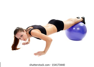 Athletic woman working out her abs and legs