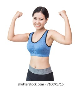 Athletic young asian woman showing biceps, asian strong woman with sportwear posing with her arms