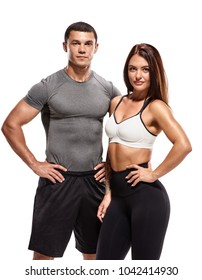 Athletic young couple in sportswear posing after training