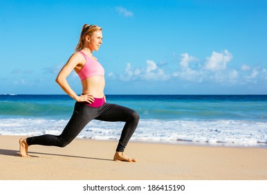 Athletic Young Fitness Woman Stretching At the Beach, Yoga workout exercise