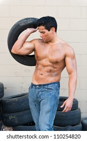 Athletic young man with auto tires