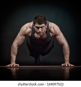 athletic young man exercising