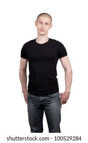 Athletic young man in jeans and t-shirt isolated on white background