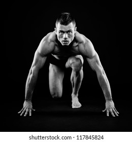 Athletic young man posing