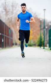 Athletic young man running in the nature. Healthy lifestyle