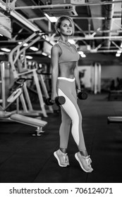 Athletic young sexy fitness woman on diet train and exercising in gym healthy living caucasian blonde girl in joy posing