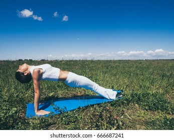 Athletic young woman doing sport exercises outside. Healthy lifestyle concept.