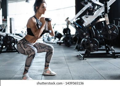 Athletic young woman fitness model doing squats exercise, concept sport healthy lifestyle