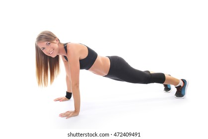 Athletic young woman practicing plank