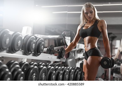 athletic young woman resting during exercise in the gym