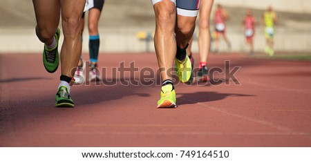 Athletics people running on the track field