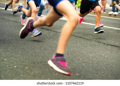 athletics runners competitors  in city race in motion blur