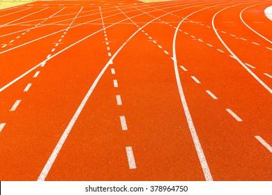 Athletics stadium running track red lines marks.