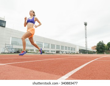 Athletics woman Track Athlete Running On Track. She is on stadium