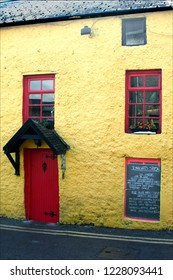 Athlone, Ireland-August 27, 2007: Entrance to small family restaurant, with red door,yellow wall and menu