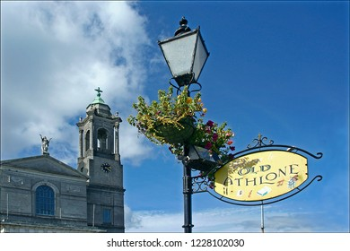 """Athlone, Ireland-August 27, 2007 Street sign for """"Old Town"""" region of Athlone, with Saints Peter and Paul's Church"""