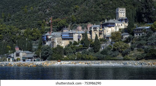 Athos peninsula, Greece. The Monastery of Dochiariou, founded in the 10th century, located in the Monks Republic on the peninsula of Athos. View from a ferry.