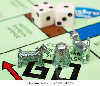 ATLANTA - APRIL 23, 2014: Close up of Monopoly game pieces on board.