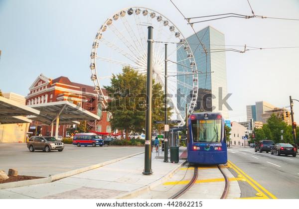 ATLANTA - AUGUST 29: Street car near the Centennial Olympic park with people on August 29, 2015 in Atlanta, GA.