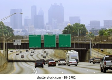 Atlanta cityscape with blank road signs.  Taken on a hazy day on the Labor Day weekend.