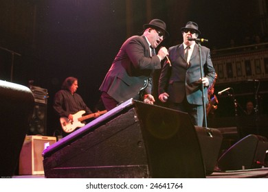 ATLANTA - FEB 7: Musical group, The Blues Brothers, featuring actors, Dan Aykroyd (R) and Jim Belushi (C) perform at The Tabernacle on February 7, 2009 in Atlanta, Georgia for the Hilles of Ga Benefit.