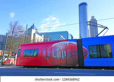 ATLANTA, GA -4 JAN 2019- View of a tram car on the street in downtown Atlanta, Georgia, advertising the NFL Superbowl LIII 53 to take place in Atlanta at the Mercedes-Benz Stadium in February 2019.
