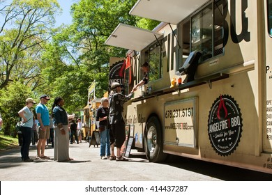 ATLANTA, GA - APRIL 16:  People stand in line to buy meals from a food truck lined up in Grant Park at the Food-o-rama festival on April 16, 2016 in Atlanta, GA.