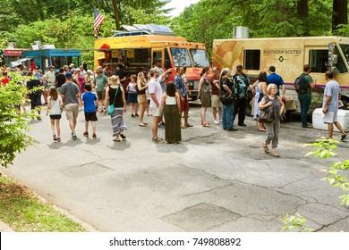 ATLANTA, GA - APRIL 29:  Several people stand in line at multiple food trucks at the Inman Park Festival on April 29, 2017 in Atlanta, GA.