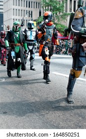 ATLANTA, GA - AUGUST 31:  Mandalorian mercenaries from the Star Wars movies walk down Peachtree Street in the annual Dragon Con parade, on August 31, 2013 in Atlanta, GA.