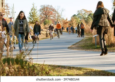 ATLANTA, GA - DECEMBER 5:  People walk, run and bike along the Atlanta Beltline recreational area in the Old Fourth Ward on December 5, 2015 in Atlanta, GA.