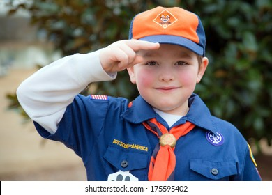 ATLANTA, GA -- FEB. 8: An unidentified Cub Scout gives the Boy Scout salute during an outdoor  event on Feb. 8, 2014. More than 1.1 million children in the U.S. participated in outdoor Scouting activities in 2013 .