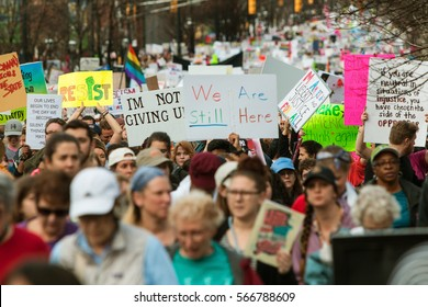 ATLANTA, GA - JANUARY 21:  A group of presidential protest signs rise above the crowd as thousands of people walk in the Atlanta march for social justice and women, on January 21, 2017 in Atlanta, GA.