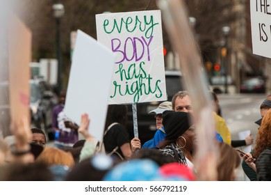 """ATLANTA, GA - JANUARY 21:  Man holds up sign saying  """"Every body has rights"""" at the Atlanta march for social justice and women, the day after Trump's inauguration, on January 21, 2017 in Atlanta, GA."""