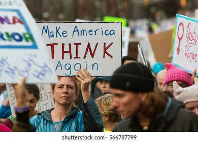 """ATLANTA, GA - JANUARY 21: Woman holds sign reading """"Make America Think Again"""" in the Atlanta march for social justice and women, the day after Trump's inauguration, on January 21, 2017 in Atlanta, GA."""
