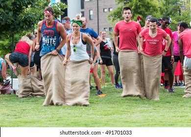 ATLANTA, GA - JULY 16:  People take part in a sack race at the Atlanta Field Day event in the Old Fourth Ward Park on July 16, 2016 in Atlanta, GA.