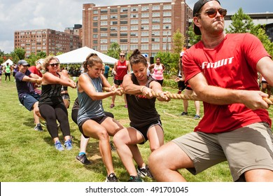 ATLANTA, GA - JULY 16:  A team of young adults pulls their rope in a tug-of-war contest as part of Atlanta Field Day in the Old Fourth Ward Park on July 16, 2016 in Atlanta, GA.