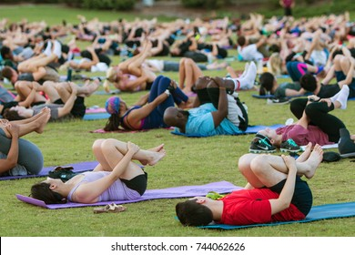 ATLANTA, GA - JULY 2:  Dozens of people do the wind running pose on their backs as they take part in a free group yoga class at the Old Fourth Ward Park on July 2, 2017 in Atlanta, GA.