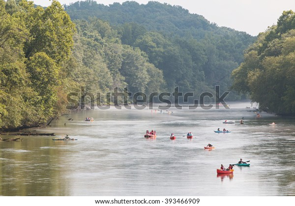 ATLANTA, GA - JULY 25:  People raft, kayak and canoe down the  Chattahoochee River on a hot summer day on July 25, 2015 in Atlanta, GA.