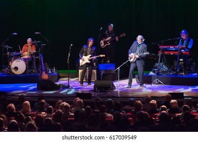 Atlanta, GA - March 31, 2017: Nitty Gritty Dirt Band in concert at Symphony Hall Jeff Hanna–Vocals,Guitars, Jimmie Fadden-Drums, Bob Carpenter-Keyboard, John McEuen-Mandolin, fiddle, Jim Photoglo-Bass