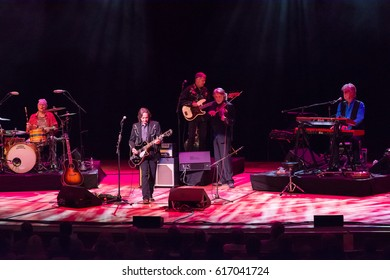 Atlanta, GA - March 31, 2017: Nitty Gritty Dirt Band in concert at Symphony Hall Atlanta Jeff Hanna – vocals, Jimmie Fadden–Drums, Bob Carpenter–Keyboards, John McEuen–fiddle, guitar,Jim Photoglo-bass