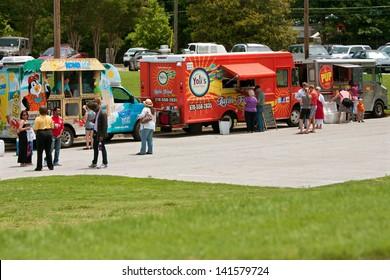 ATLANTA, GA - MAY 25: Patrons buy food from food trucks at the GREAT festival, an event celebrating Great Britain and the United Kingdom on May 25, 2013 in Atlanta, GA.