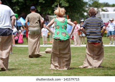 ATLANTA, GA - MAY 25:  Several unidentified people compete in a sack race at the GREAT festival, a spring festival celebrating Great Britain and the United Kingdom on May 25, 2013 in Atlanta, GA.