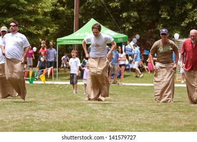 ATLANTA, GA - MAY 25:  Several unidentified men compete in a sack race at the GREAT festival, a spring festival celebrating Great Britain and the United Kingdom on May 25, 2013 in Atlanta, Ga.