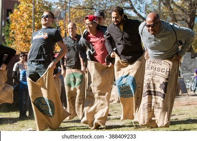 ATLANTA, GA - NOVEMBER 14:  Men compete in an old-fashioned sack race at the King of Pops Festival on November 14, 2015 in Atlanta, GA.